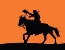 Cowboy auf einem Pferden-Schattenbild Stockfoto