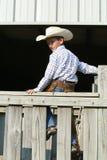 Cowboy auf einem Zaun Lizenzfreies Stockfoto