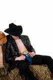 Cowboy auf Heu lizenzfreie stockbilder