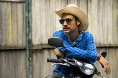 Cowboy auf Motorrad Stockbild