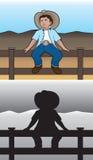 Cowboy auf Zaun Stockbilder