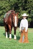 Cowboy avec son cheval Photographie stock