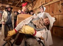 Cowboy bêbedo na cadeira de rodas fotografia de stock royalty free