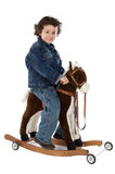 Cowboy baby. White bottom mounted white bottom in a toy horse royalty free stock image