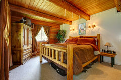 Cowboy bedroom interior with wood ceiling. Stock Photography