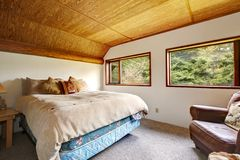 Cowboy bedroom with wood ceiling and wood view. Stock Photo