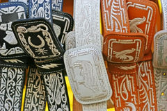 Cowboy belts. Black, orange and white cowboy belts from Mexico stock images