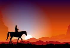 Cowboy bij Zonsondergang Stock Afbeelding