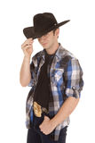 Cowboy with black hat one eye hidden Stock Photo