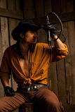 Cowboy with Black Leather Flogging Whip Royalty Free Stock Photography