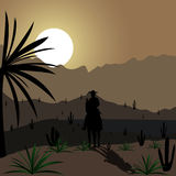 Cowboy. Black silhouette of a cowboy on a horse at sunset Royalty Free Stock Image