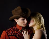 Cowboy and blond girl Royalty Free Stock Photo