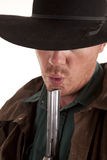 Cowboy blow on gun Royalty Free Stock Image
