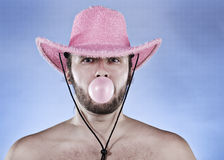 Cowboy blowing a gumball. Stock Photo