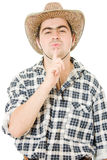 Cowboy blows on his finger. Royalty Free Stock Images