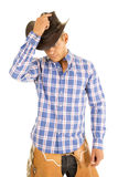 Cowboy blue plaid shirt hold hat on head Royalty Free Stock Photography