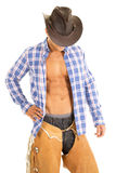 Cowboy blue plaid shirt look down face hidden Royalty Free Stock Image