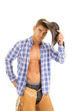 Cowboy blue plaid shirt look serious hold hat Royalty Free Stock Photo
