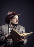 Cowboy with book Royalty Free Stock Photo