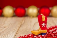 Cowboy boot on christmas wood holiday background Stock Photography