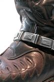 Cowboy boot closeup. Detail of a dark cowboy boot with chain and decorative stitching stock image