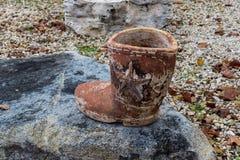 Cowboy Boot on a Rock Stock Photos