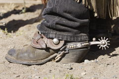 Cowboy Boot & Spur. Closeup of worn cowboy boot with spur stock photo