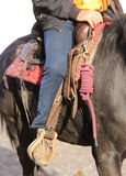 Cowboy boot in the stirrup of the horse during the ride Stock Photos