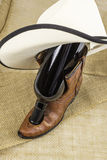 Cowboy Boot and Wine Bottle Royalty Free Stock Image