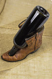 Cowboy Boot and Wine Bottle Royalty Free Stock Photos