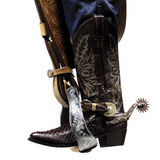 Cowboy boots. Resting on the stirrup Stock Photography