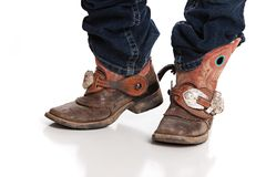 Cowboy Boots. Worn and muddy cowboy boots with spurs. on white stock photo