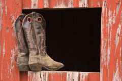 Cowboy Boots. In a barn window Stock Photos