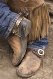 Cowboy Boots. Cowboy's feet in boots and chaps Stock Photo