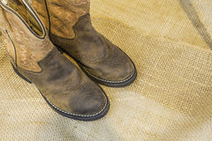 Cowboy Boots on Burlap Royalty Free Stock Images