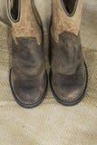 Cowboy Boots on Burlap Stock Images