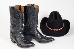 Cowboy Boots and Cowboy Hat. Black Lizard Cowboy Boots and Cowboy Hat with Brightly Colored Hatband royalty free stock images