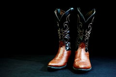 Cowboy boots with cowhide upper. Royalty Free Stock Image