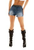 Cowboy boots and denim shorts Stock Photos