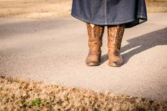 Cowboy Boots and Denim Skirt royalty free stock photo