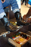 Cowboy boots getting a shine - vertical Stock Photography