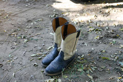 Cowboy boots. On the ground royalty free stock image