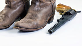 Cowboy boots and Guns. Old cowboy boots and old cowboy pistol with room for your type Stock Photos