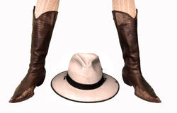 Cowboy Boots and Hat. Woman legs with cowboy boots and a hat at center, on white background stock image