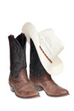 Cowboy boots with hat. Isolated over white, clipping path Royalty Free Stock Photos