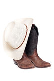 Cowboy boots with hat. Isolated over white, clipping path Stock Photography