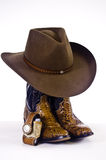 Cowboy boots and hat Stock Images