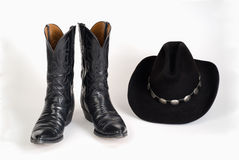 Cowboy Boots and Hat with Concho Hatband. Black Lizard Cowboy Boots and Cowboy Hat with Sterling Silver Concho Hatband stock image