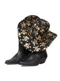 Cowboy boots and hat Stock Photos