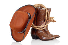 Cowboy boots hat and lasso. With reflection stock image